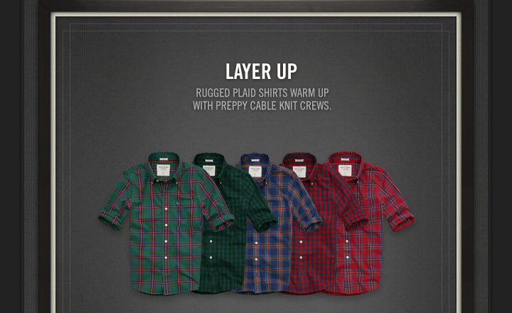 LAYER UP RUGGED PLAID SHIRTS WARM UP WITH PREPPY CABLE KNIT CREWS.