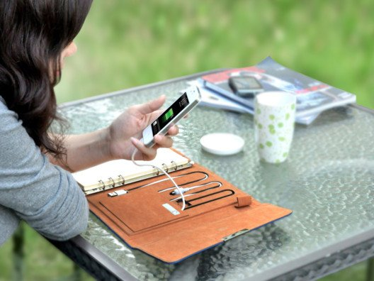 This stylish notebook has a place to keep business cards and credit cards and is a stealthy charger for your phones and tablets.