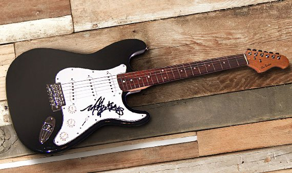 Autographed Celebrity Guitars - Visit Event