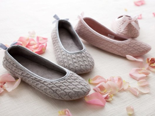 "Not only does the cushioned micro-suede keep your feet comfy and warm on the inside, but these also have a super cute ""ballerina"" slipper look."