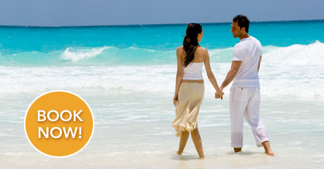 Couple walking on beach at Palace Resort in Mexico