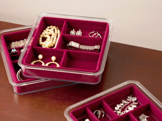 This unique jewelry organizer offers a unique stacking and sliding feature, allowing you to utilize in-drawer or on-counter space.