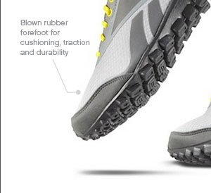 Blown rubber forefoot for cushioning, traction and durability