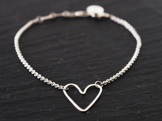 I wear this delicate bracelet because it symbolizes all the different forms of love in my life. It's the perfect Valentine's Day charm.