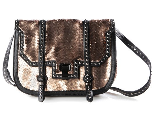 Sparkle on your way to the office with these sequins! A day-friendly shape and casual leather trims make this crossbody a perfect work or weekend bag.