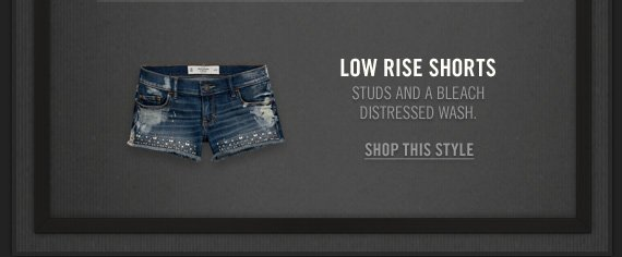LOW RISE SHORTS          STUDS AND BLEACH DISTRESSED WASH.          SHOP THIS STYLE