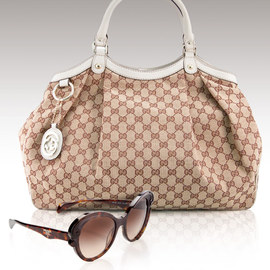 Prada, Gucci & Dior