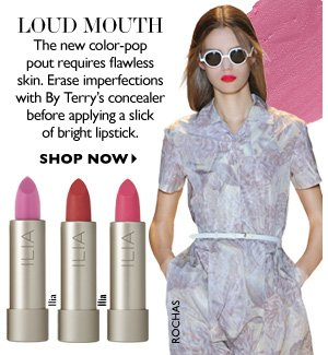 LOUD MOUTH The new color-pop pout requires flawless skin. Erase imperfections with By Terry's concealer before applying a slick of bright lipstick. SHOP NOW