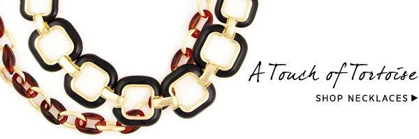 A Touch of Tortoise. Shop Necklaces