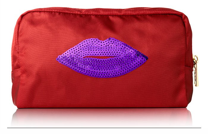 Limited Edition Pochette: An audacious embellished cosmetic pochette in a racy crimson Italian nylon.