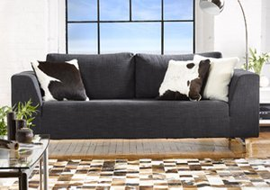 Natural Brand: Hide Rugs & Pillows