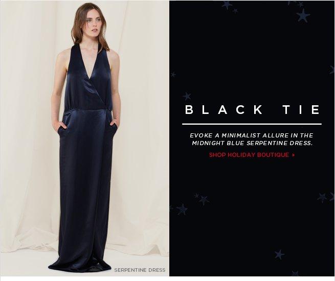 Black Tie: Evoke a minimalist allure in the midnight blue serpentine dress.