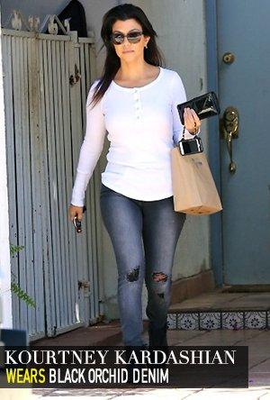 Kourtney Kardashian in Black Orchid