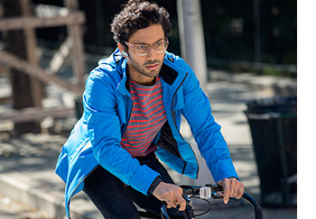 Man riding bike with ERA headset