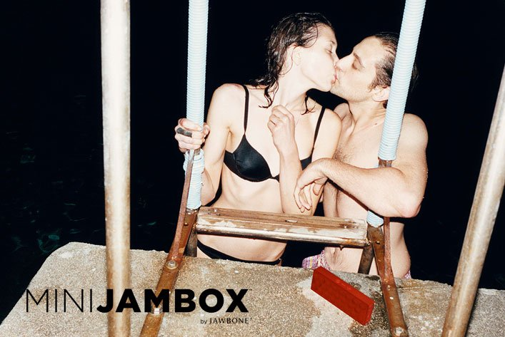 Couple kissing with MINI JAMBOX.