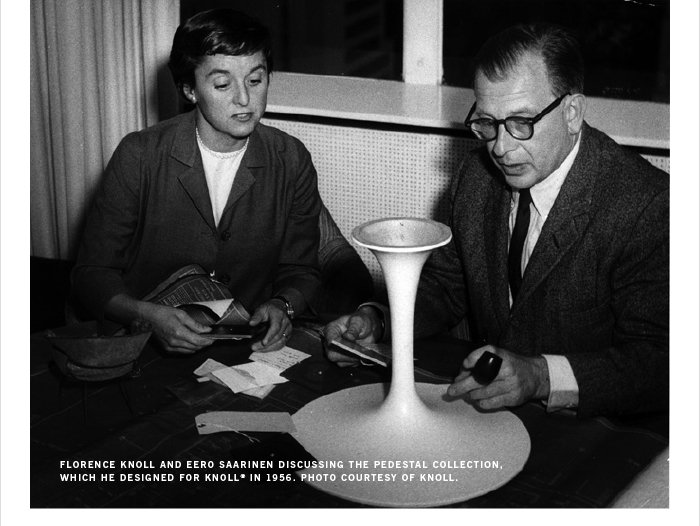 FLORENCE KNOLL AND EERO SAARINEN DISCUSSING THE PEDESTAL COLLECTION, WHICH HE DESIGNED FOR KNOLL® IN 1956. PHOTO COURTESY OF KNOLL.