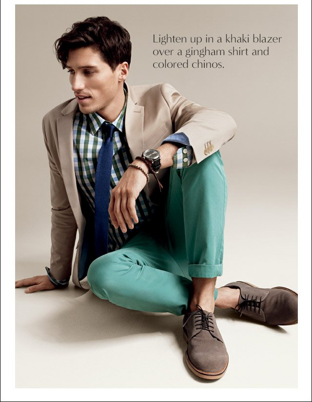Lighten up in a khaki blazer over a gingham shirt and colored chinos.