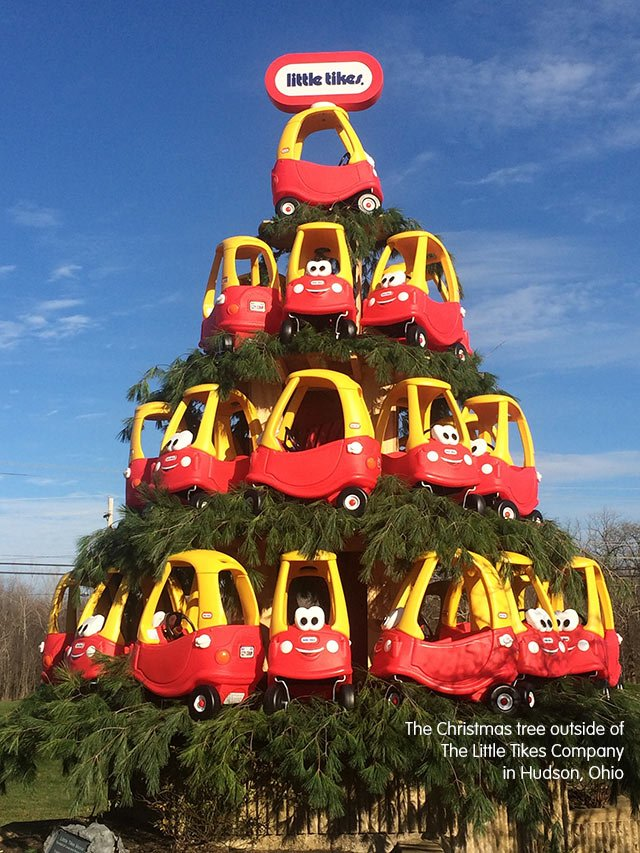 a giant christmas tree created with cozy coupes