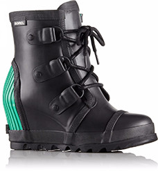 A black wedge boot with green accents.