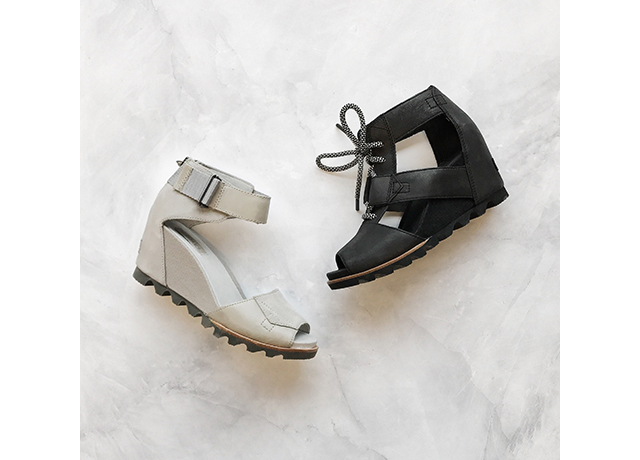 Two wedge sandals, one black, one off white.