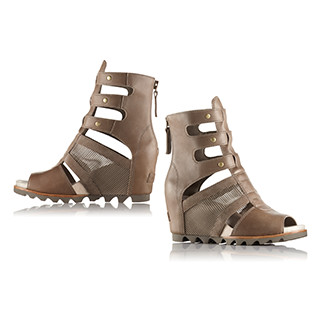 A pair of brown gladiator sandals.