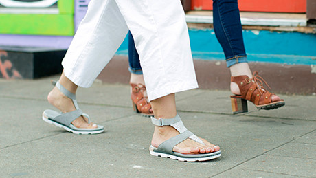 An image of two women wearing sandals.