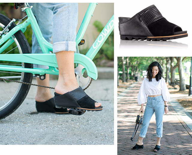 Images of a woman wearing black Joanie mule wedges in a city setting.