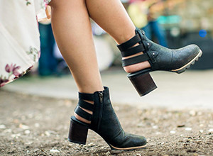 A close-up of a woman wearing black Addington Bootie boots.