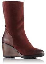 A mid-hi wedge boot with heel.