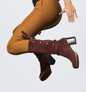 Close-up of a young woman wearing burgundy Farah Mid boots.