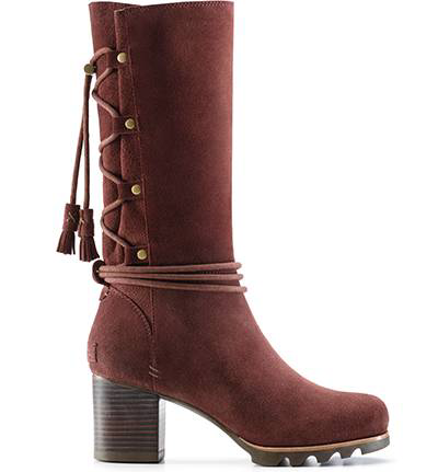 A boot with a heel and tassel detail.