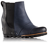 A mid-hi wedge boot with gore detail.