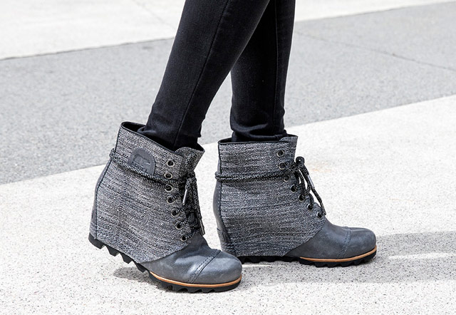 Close-up of a woman wearing the metallic gray and black PDX Wedge.