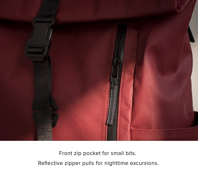 Front zip pocket for small bits. Reflective zipper pulls for nighttime excursions.