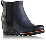 Profile of a navy blue Chelsea wedge boot.
