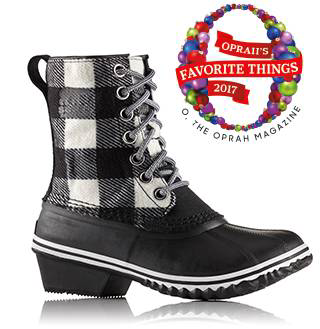 A profile view of a lace-up wedge boot.