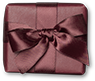 A marron gift on maroon background.