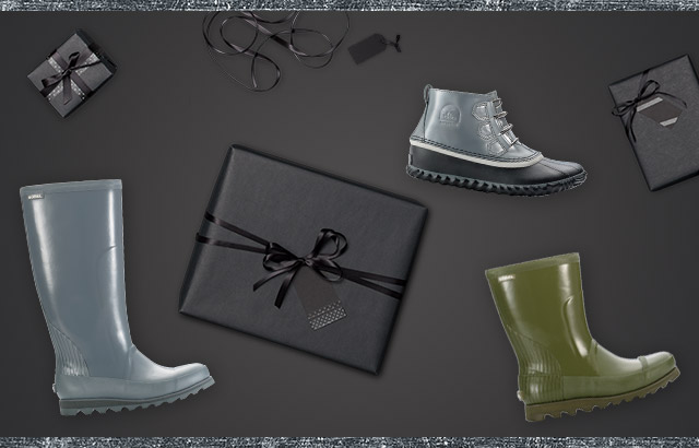 Three rain boots against a black background and wrapped gifts.
