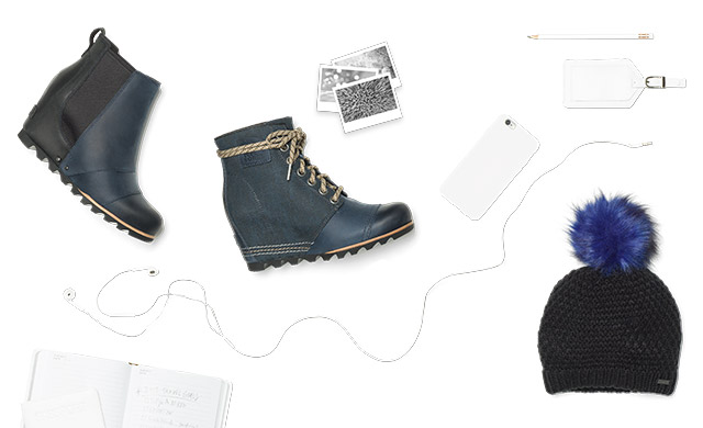 Boots, a beanie, a cell phone against a white background.