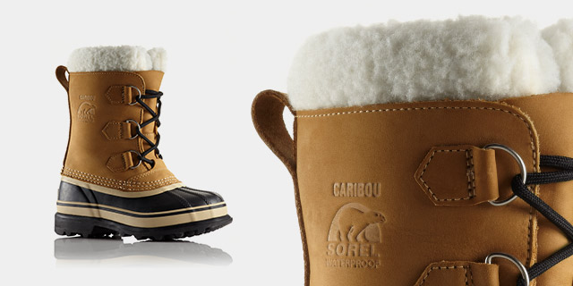 A profile view of mid-length snow boots.