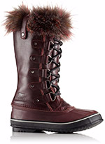 A tall snow boot with fur.