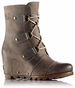 A profile view of a brown wedge boot.