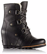 A profile view of a black wedge boot.