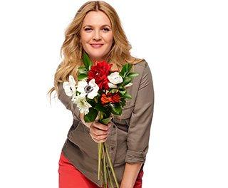 Drew Barrymore holding a flower