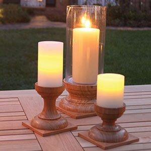 Teak candleholders and lanterns
