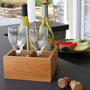 Our teak and stainless steel wine caddy and wine stoppers