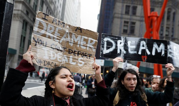 Marchers supporting DACA in February walked up Broadway. A ruling by a federal judge found that President Trump's campaign comments on immigrants were within the scope of the case.