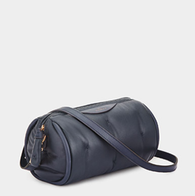 barrel cross body bag