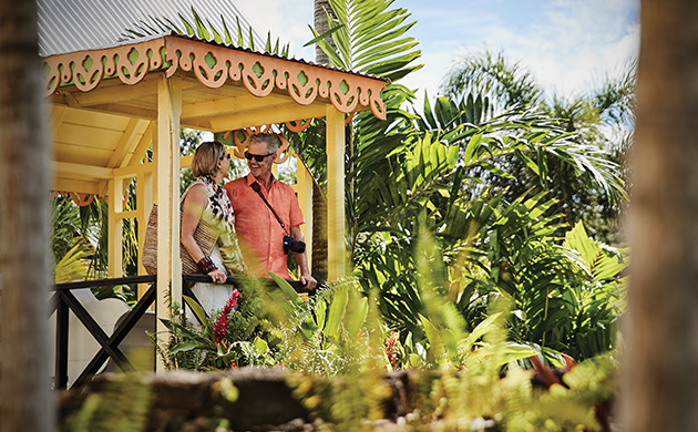 Image of couple at Romney Manor in St. Kitts surrounded by greenery - Click here to book now