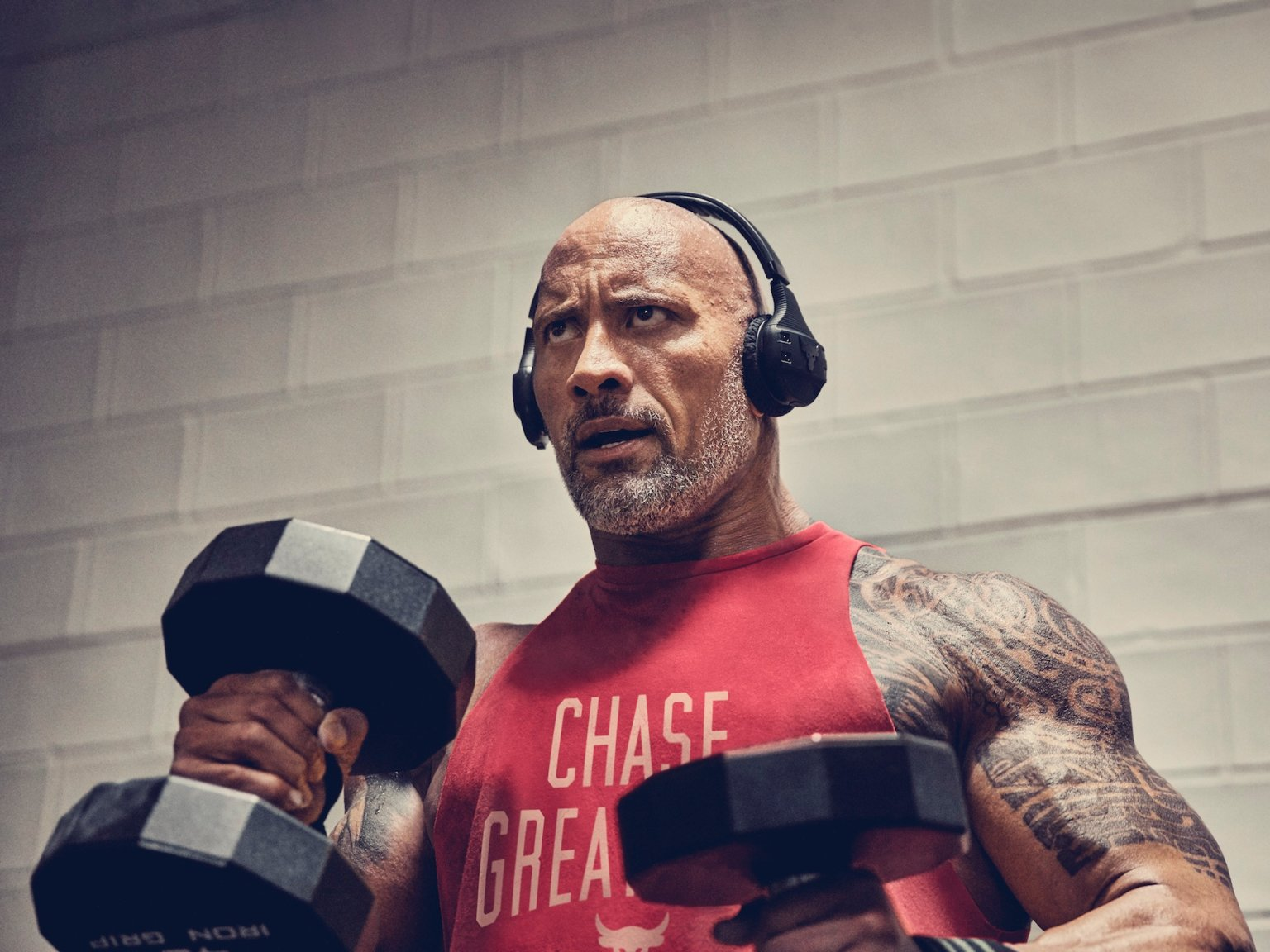 Dwayne Johnson teamed up with Under Armour and JBL to make wireless headphones that won't fall off when you work out  here's what they're like